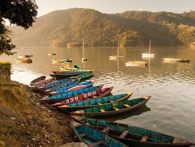 A Sunrise Paddle on Phewa Lake, Pokhara Valley, Kaski District, Nepal.