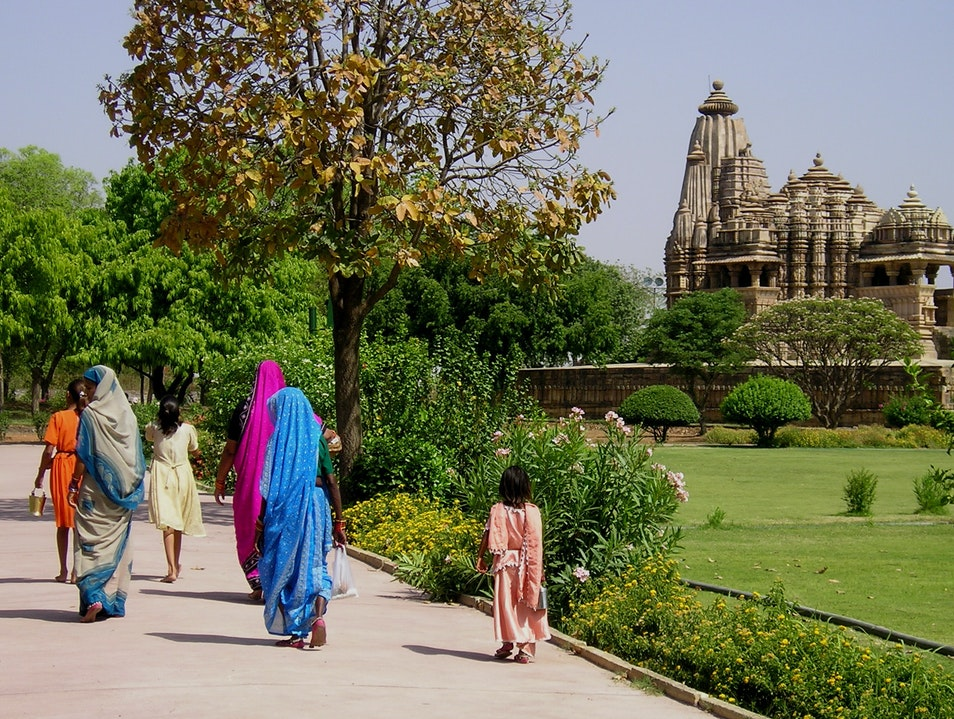 Women on their way to puja Khajuraho  India
