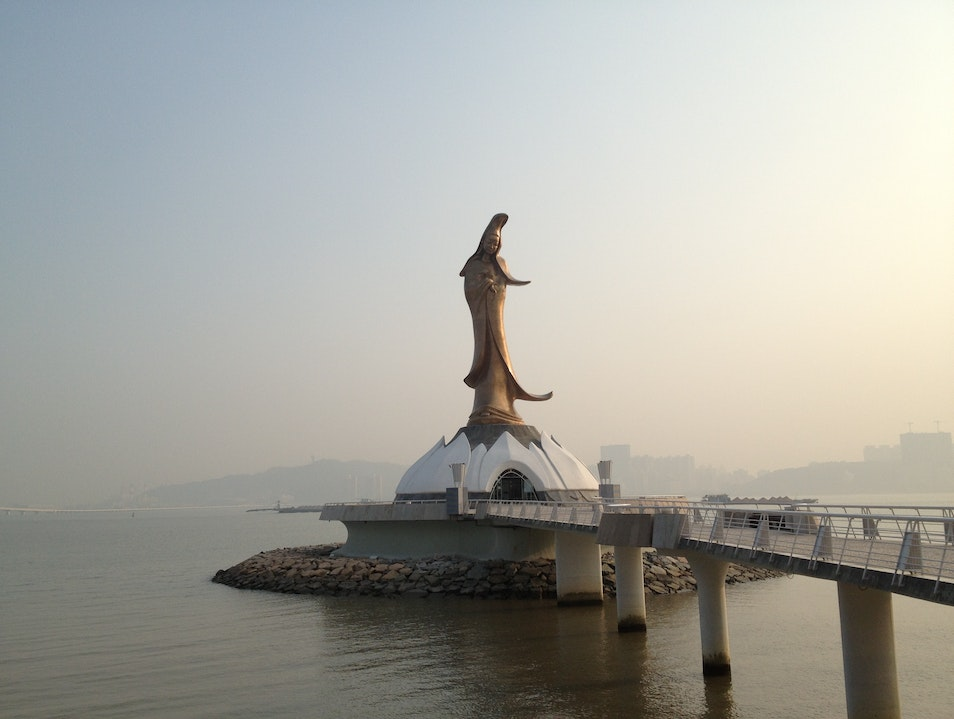 """Guanyin """"Goddess of Mercy"""" Statue  floating above the sea"""