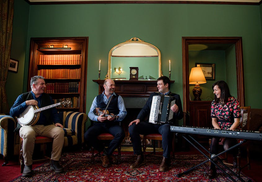Meet the Glenfinnan Cèilidh Band (from left): Colm O'Rua (Daimh) on banjo, Iain MacFarlane (Blazin' Fiddles) on fiddle, Dougie Hunter (Hoogie) on accordion, and Ingrid Henderson (Cliar) on piano.