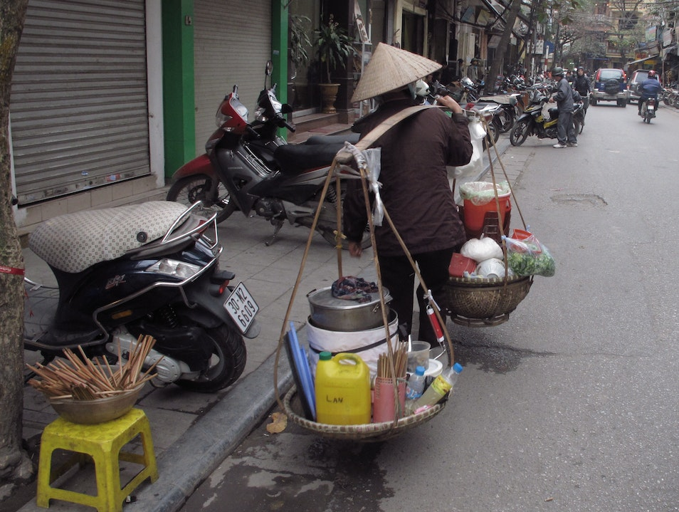 Carrying her kitchen on her back. Hanoi  Vietnam