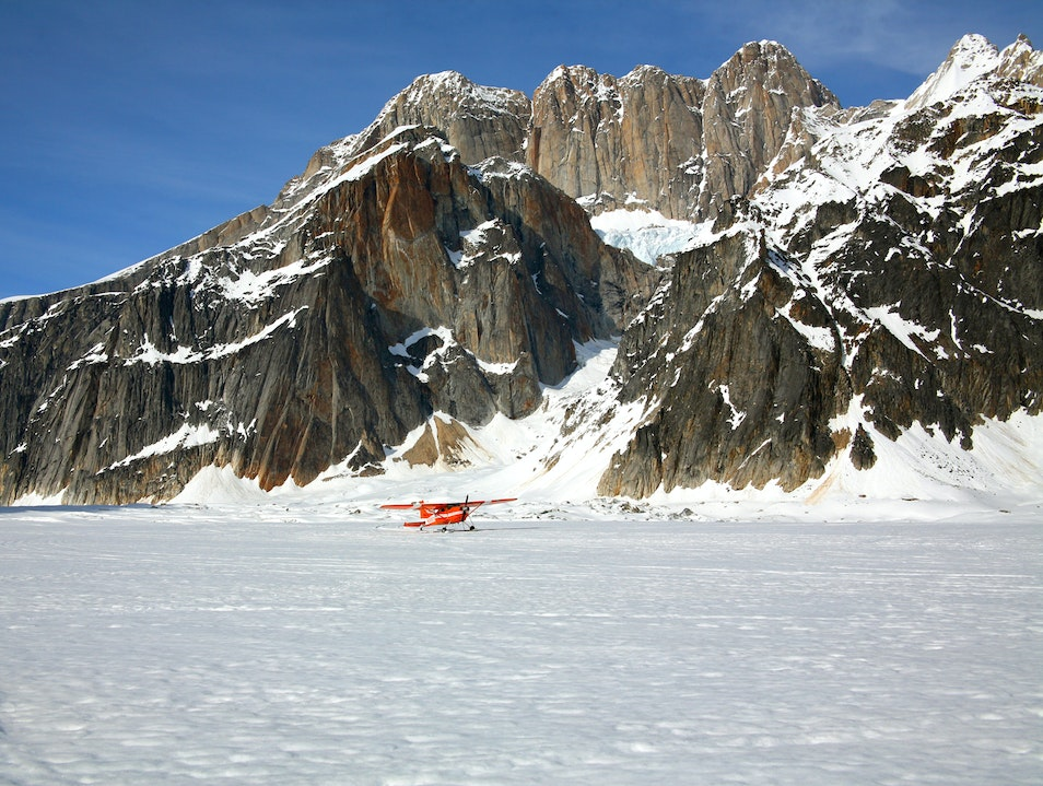 Airplane on Ski's lands on glacier