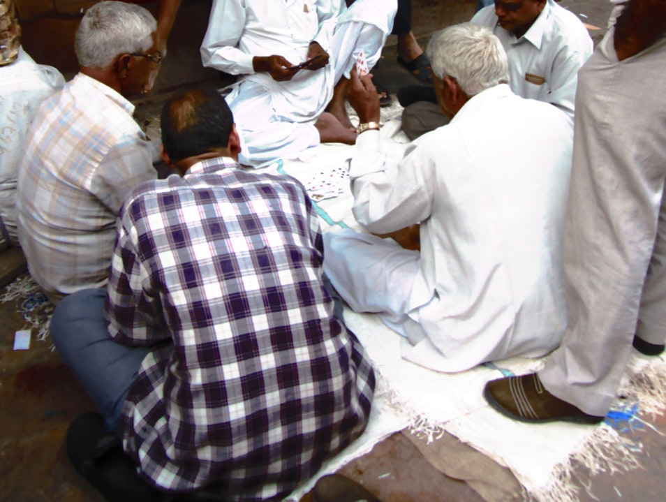 Interrupting the flow of traffic for a quick card game Bikaner  India