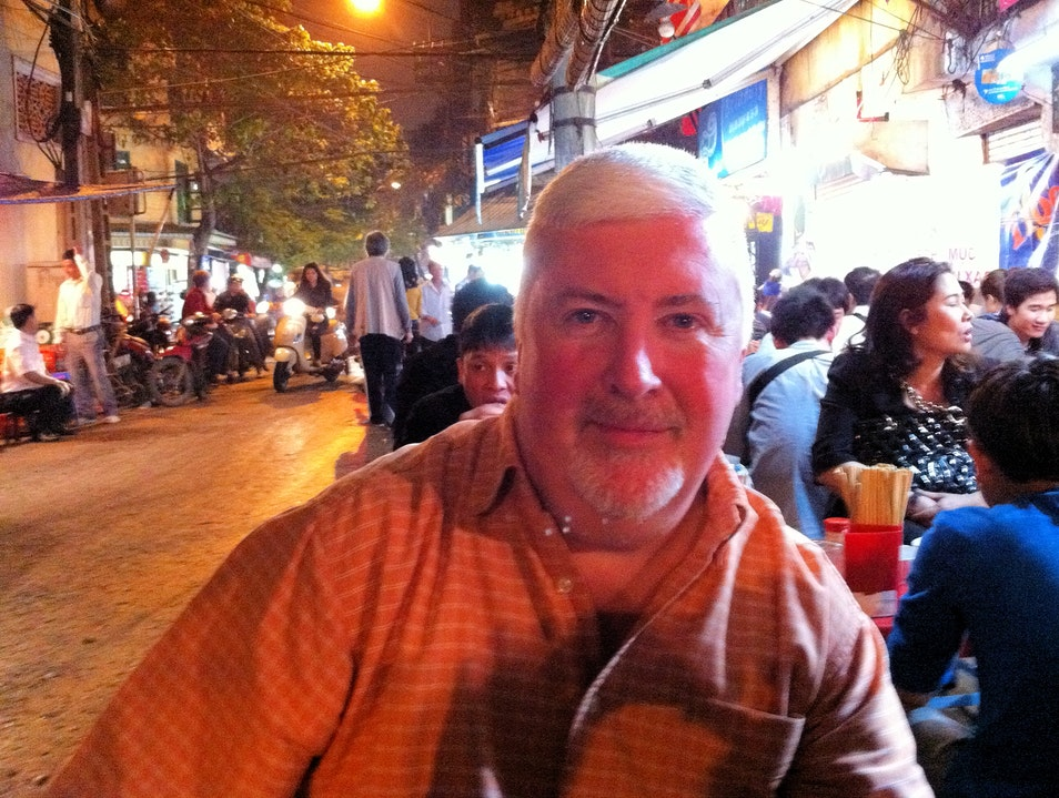 Eating at a curbside restaurant in Hanoi