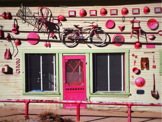 Unlikely art: Façade of found objects--RED!