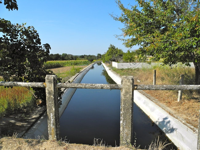 The Acude Waters Flow to the Fields Through the Canal
