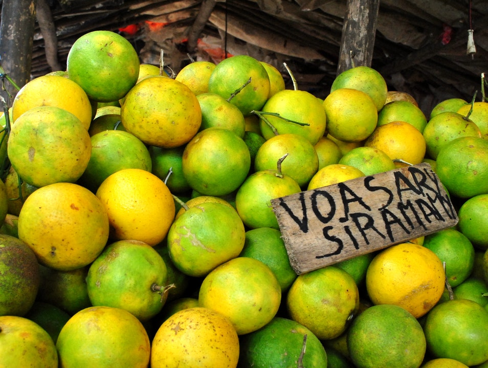 Fruit Stalls and Souvenirs at the Bazary Be Market Toamasina  Madagascar