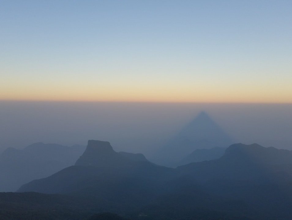 The shadow of Adam's Peak seen from the top at sunrise. Peak Wilderness Sanctuary  Sri Lanka