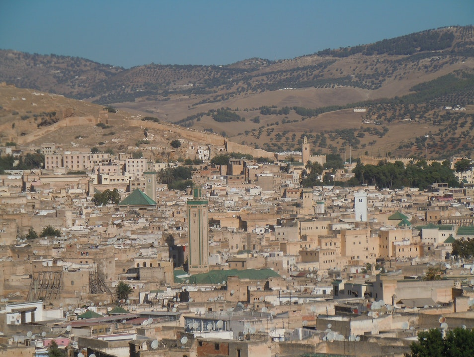 A skyline of roof tops filled with satellite dishes in Fez, Morocco
