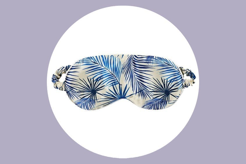 For sleeping on planes or too-bright hotel rooms, a sleep mask is an essential travel accessory.
