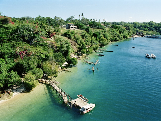 Watch the azure waters of Kilifi creek leak out into the Indian ocean