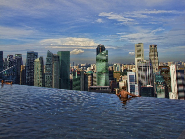 Swimming at the edge of the sky at Marina Bay Sands Hotel, Singapore