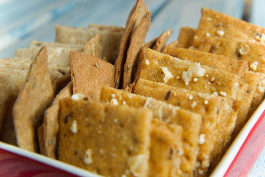 Pack plenty of healthy snacks, like whole wheat crackers, to keep you fueled during long stretches of driving.