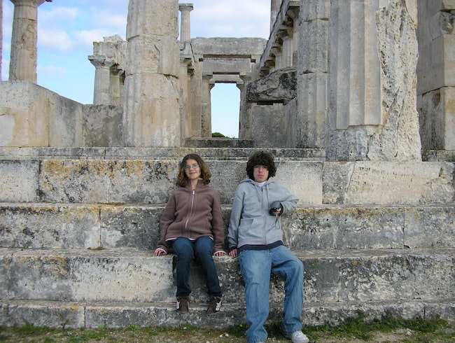 Two of my kids at the Temple of Aphaea on the island of Aegina, Greece.