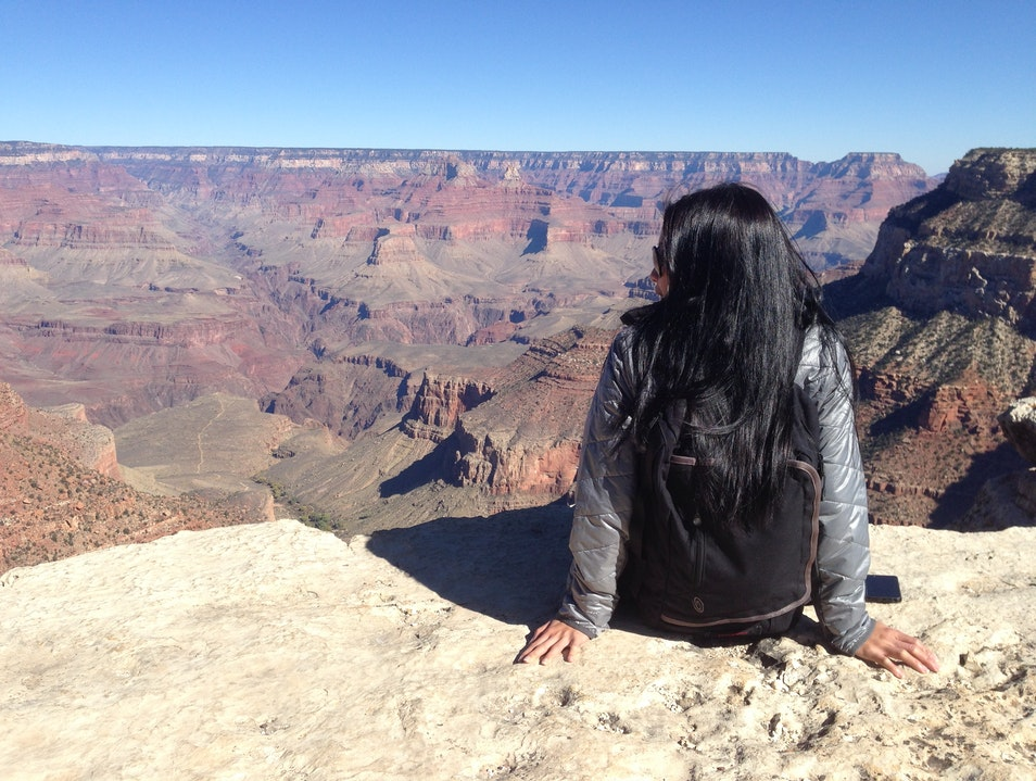 Sitting on the edge of the Grand Canyon Winslow Arizona United States