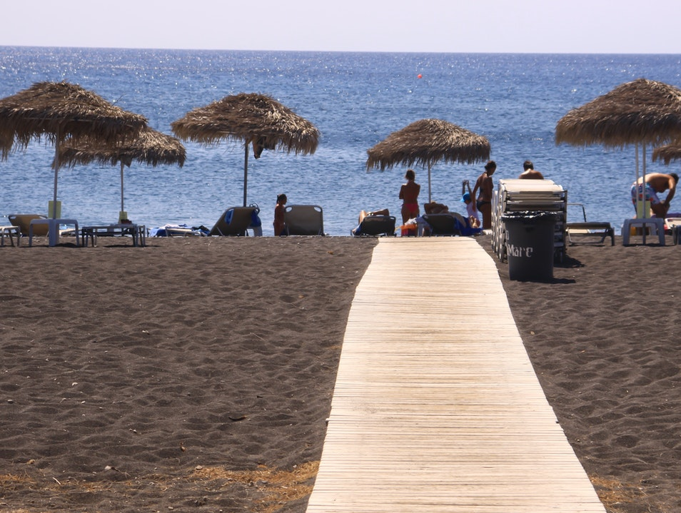 These boardwalks are quite useful, the sand is hot! Thira  Greece
