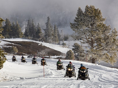 Snowmobiling in Yellowstone National Park CODY Wyoming United States