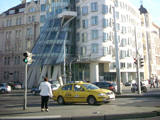 Pose for pictures in front of Prague's Dancing House