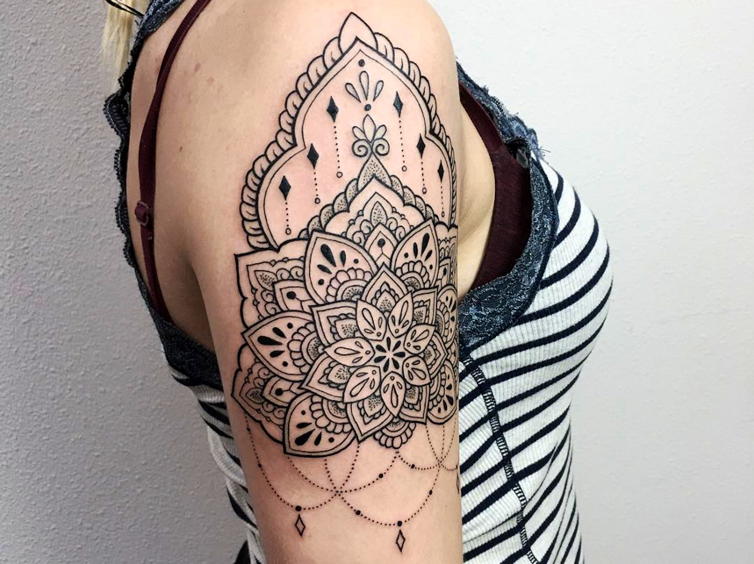Artist James Nidecker's blackwork showcases New Amsterdam Tattoo Studio's ornamental strengths.