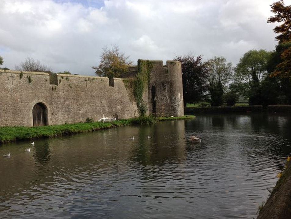 Wander the gardens around a moated palace Wells  United Kingdom