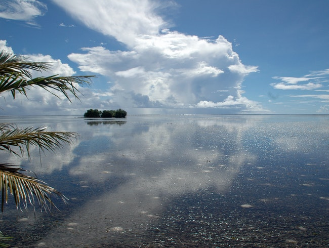 Kosrae's Glassy Water Slithers to Shore