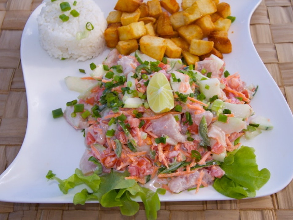 Try local seafood specialties like poisson cru Vaitape  French Polynesia