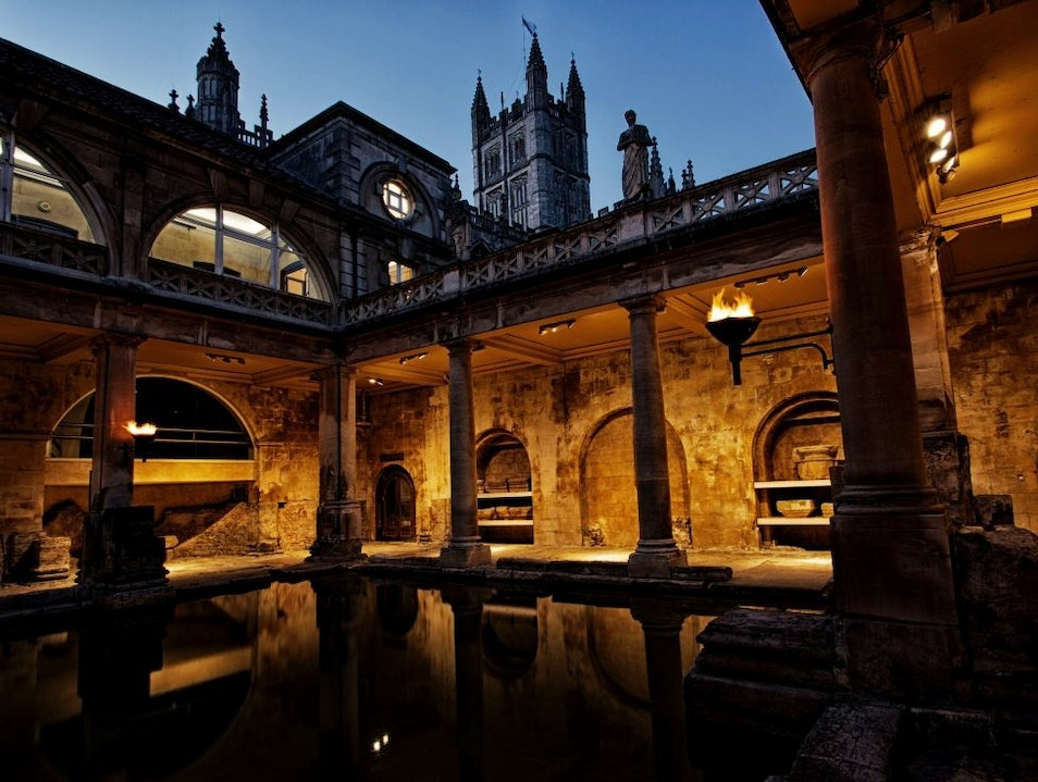 Enchanted by the Torch-lit Roman Bath at night Avon  United Kingdom