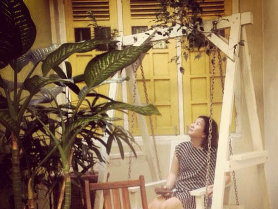 The lovely courtyard swing at Mango Tree Place