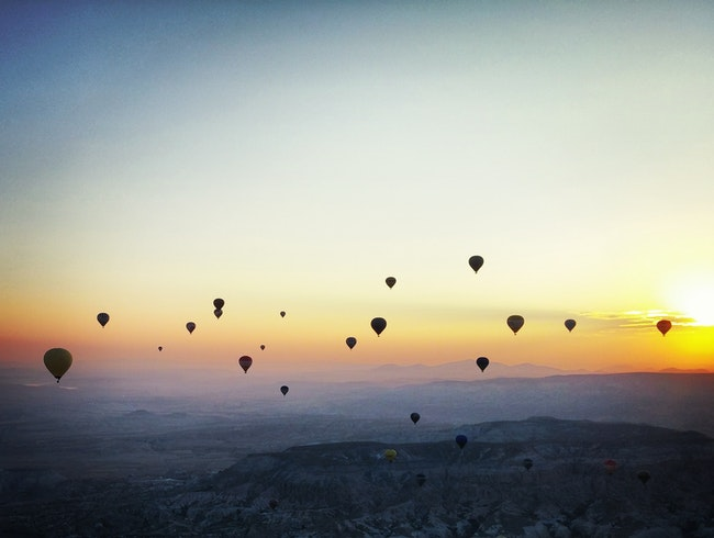 Hot air balloon ride at sunrise