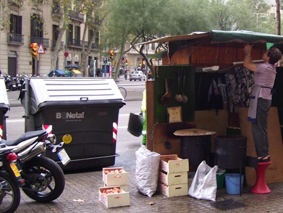 Savor freshly roasted chestnuts and sweet potatoes from una castanyera Barcelona  Spain