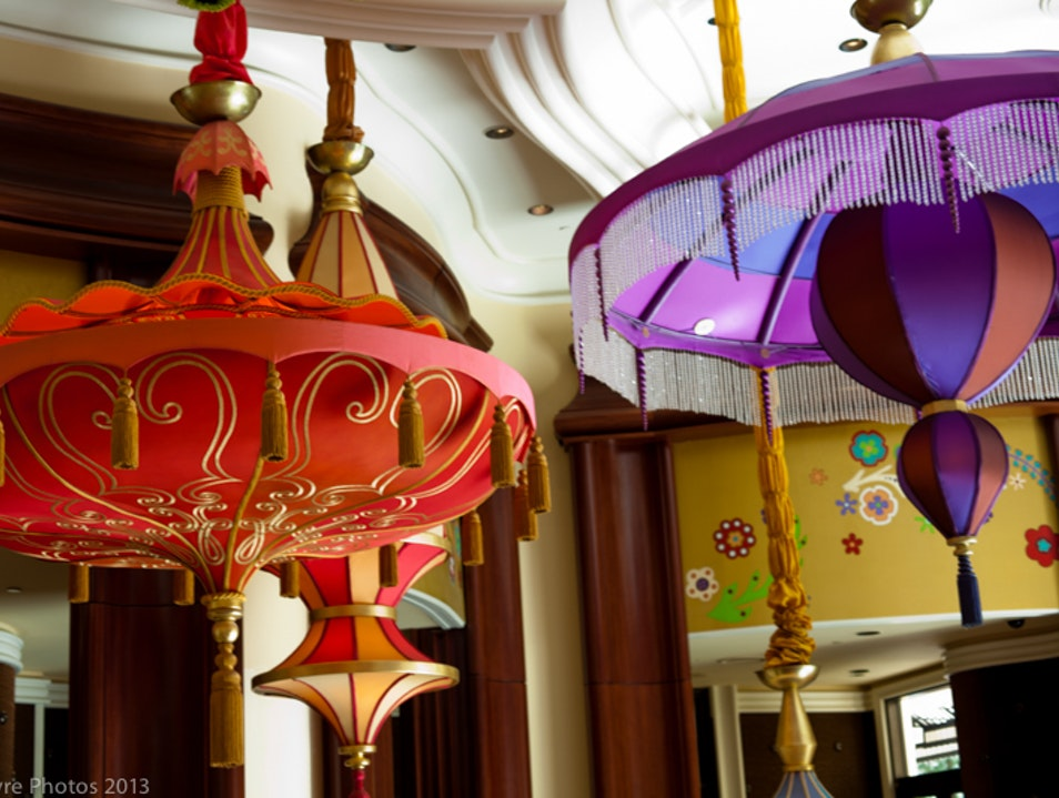 Have a drink under colorful decor at the Parasol Up bar at the Winn in Las Vegas