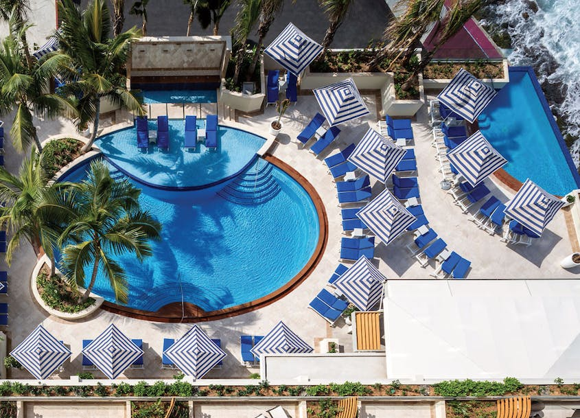 The Condado Vanderbilt Hotel features 212 guest rooms, four pools, and three dining options.