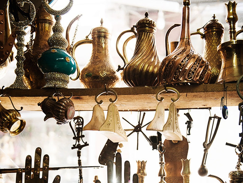 Digging through junk shops in the Grand Bazaar Istanbul  Turkey
