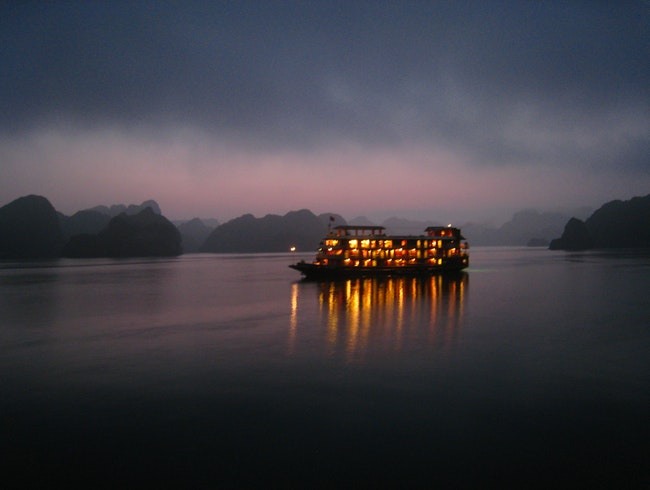 Hazy, purple sunset over Halong Bay, Vietnam