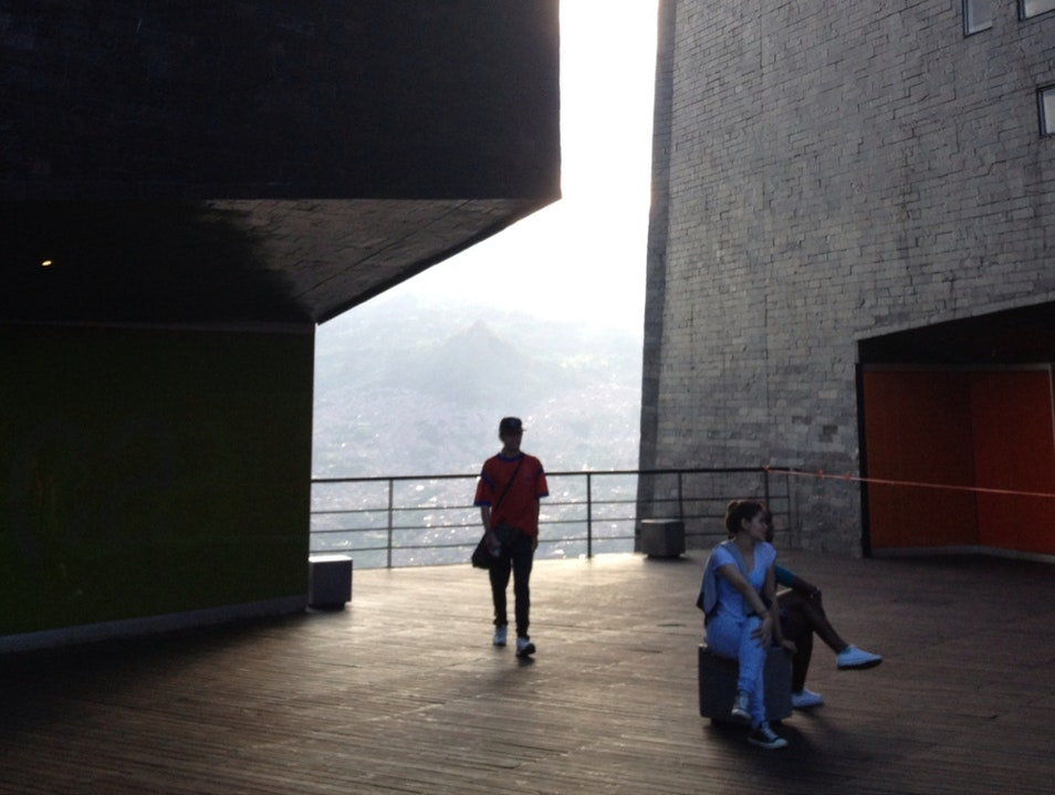 A Modern Library Perched On A Mountainside Is A Source Of Civic Pride