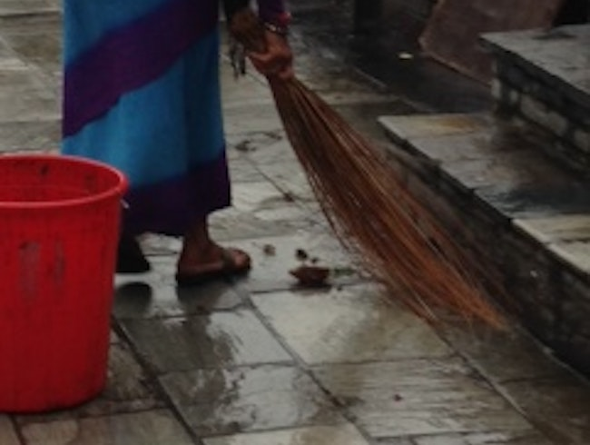 Sweeping Before the Candle Ceremony on the Ganges
