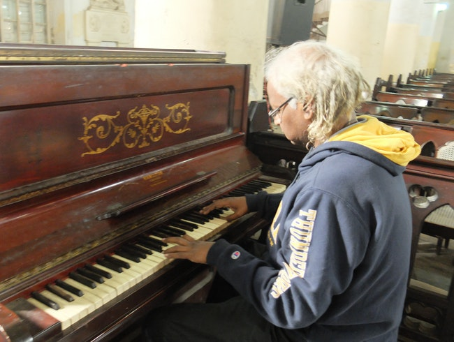The Organist at the Piano