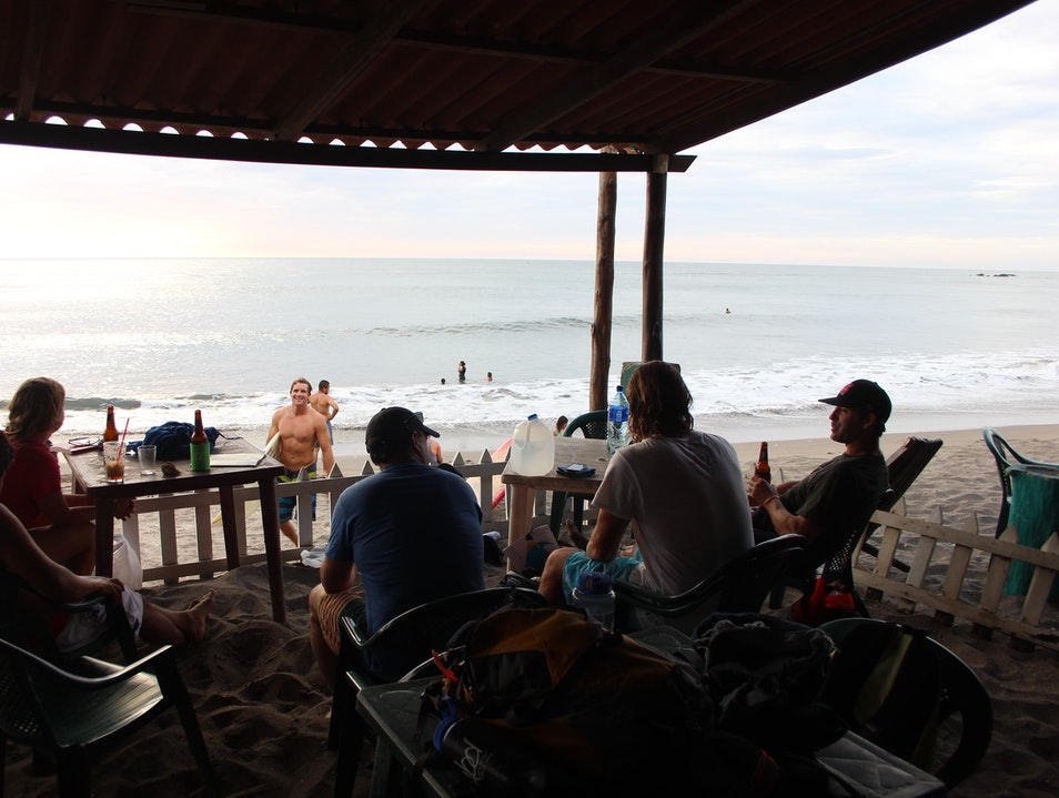 Surfing, eating fish tacos, sipping a Tona, and watching the sunset.
