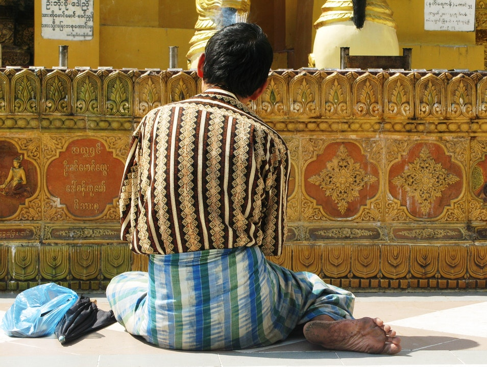 Praying at Shwedagon Pagoda Rangoon  Myanmar