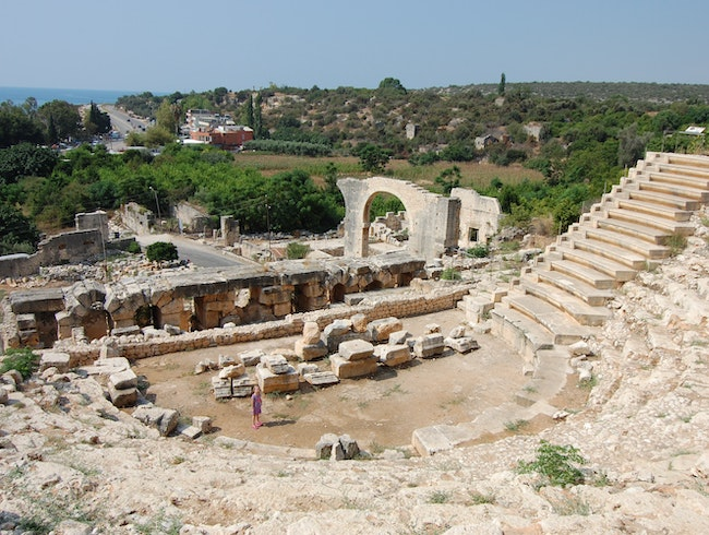 Walk through the Roman market and Amphitheater of an ancient Roman town overlooking the sea