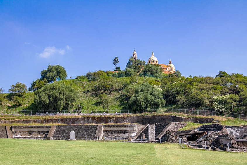 The ancient city of Cholula is home to the largest pyramid by volume in the world.