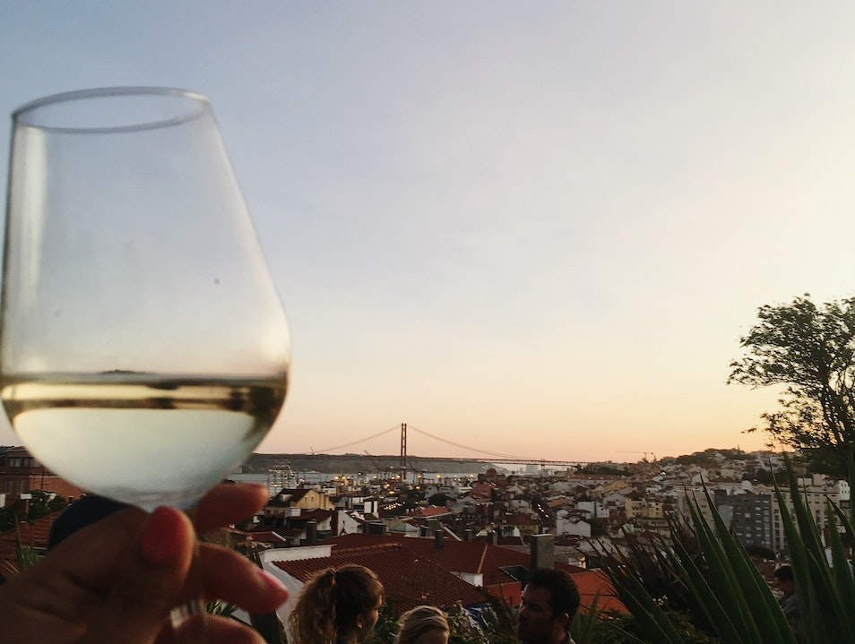 Fine views, fine wine, fine company all from the rooftop of a parking garage Lisbon  Portugal