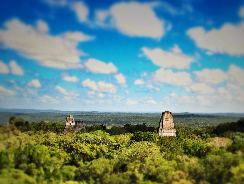 Above the jungle canopy, Mayan temples