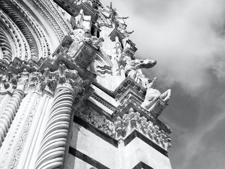 Looking up Façade of Siena Cathedral Siena  Italy