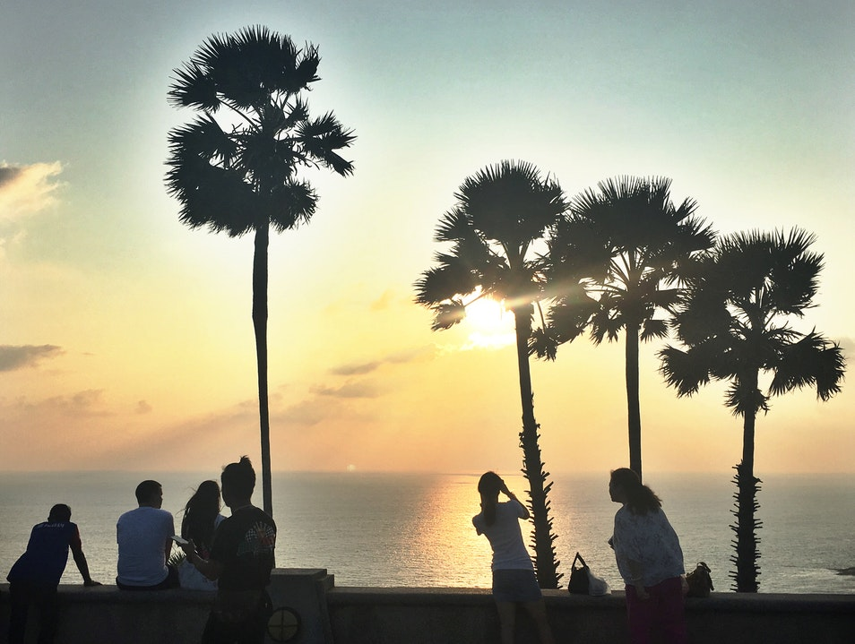 Catch a view of the sunset and some great people watching in Phuket Si Sunthon  Thailand