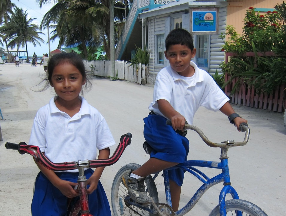 No cars on Caye Caulker; locals go barefoot or by bike. Two Belizean school kids stop for a smile and a photograph. Belize  Belize