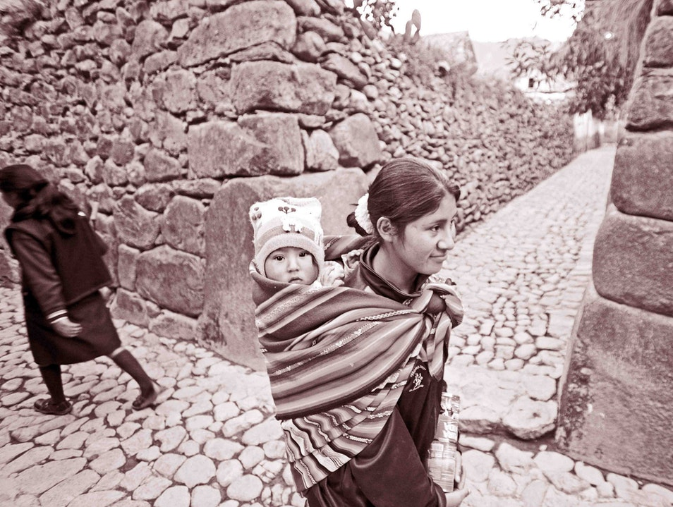 Passing two local girls in route to the market Cusco  Peru