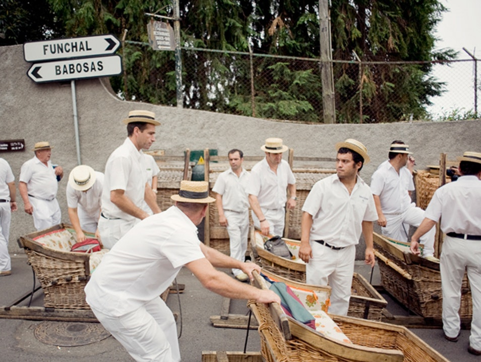Riding a wicker sled down the hills of Funchal