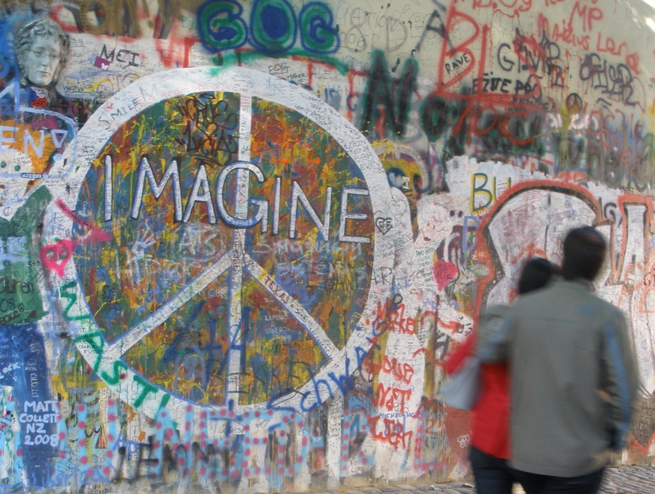 Speaking Words of Wisdom at the John Lennon Wall Prague  Czech Republic