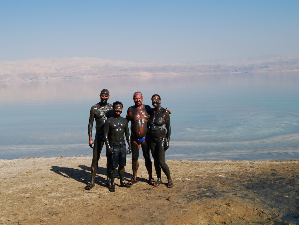 Putting on Black Mud in the Dead Sea   Earth